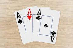 3 do ás amáveis - casino que joga cartões do pôquer foto de stock royalty free