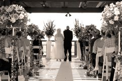 We do. Bride and groom getting married Stock Photography