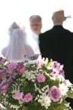 We do. Bride and groom with Pastor getting married Royalty Free Stock Photos