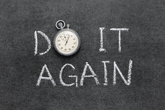 Do it again. Phrase handwritten on chalkboard with vintage precise stopwatch used instead of O royalty free stock image