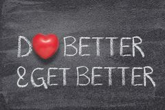 Do better and get heart. Do better and get better phrase written on chalkboard with red heart symbol stock image
