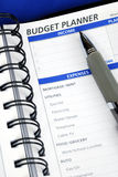 Do the budget planning on the day planner Stock Photos