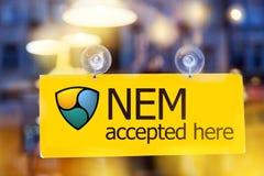 Do dinheiro cryptocurrency virtual NEM - NEM a moeda de XEM aceitou h fotos de stock