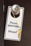 Do disturb. Lonely plea for attention - a sign and keys hanging on a doorknob royalty free stock images