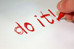 Do it!. Do it hand written in red crayon on white paper Stock Photos
