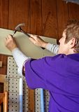 Do It Herself. Single Senior Citizen has learned to do many carpentry projects herself Stock Image