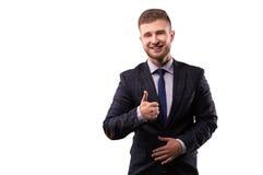 Do homem de negócios do sorriso e das mostras polegar acima fotografia de stock