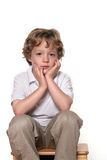 Do I have too?. Shot of a four year old boy on white Royalty Free Stock Photography