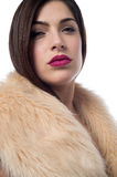 Do i look stylish ?. Pretty trendy woman in luxurious fur coat Royalty Free Stock Images