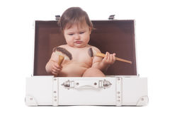 Do I need that?. Pensive adorable girl sitting in the case with make-up brushes stock photos