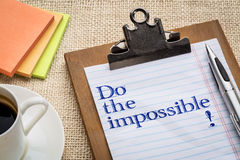 Do the impossible - clipboard Stock Image