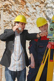Do it like i say. Boss and worker working with measuring tool Royalty Free Stock Images