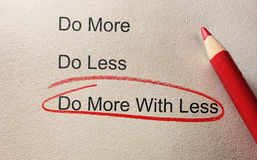 Do more with less. Circled in red pencil Royalty Free Stock Image