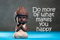 Do more of what makes you happy - inspirational background with white statuette of Buddha. Yoga and meditation concept.  royalty free stock photo