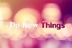 Do new things inspiration. Inspiration quote DO NEW THINGS and bokeh background stock photo