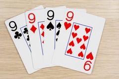 4 do nines amáveis 9 - casino que joga cartões do pôquer foto de stock