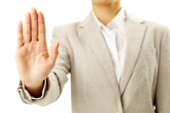 Do not approach. Image of female hand showing sign of stop Stock Images