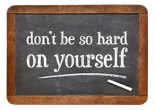 Do not be so hard on yourself - blackboard sign Royalty Free Stock Photo