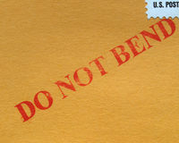 Do not bend. Warning printed on a cardboard Stock Images