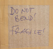 Do not bend! Fragile! Stock Image