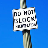 Do not block intersection sign. Over the blue sky Royalty Free Stock Photo