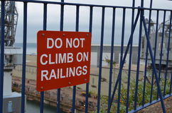 Do not climb on railings sign. Stock Images