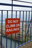 Do not climb on railings sign. Royalty Free Stock Photography