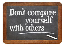 Do not compare yourself with others - blackboard sign Royalty Free Stock Photo