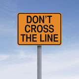 Do Not Cross The Line. A road sign indicating Don't Cross The Line royalty free stock photos