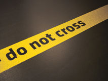 Do not cross sign. Do not trespass this line stock photography