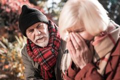 Nice unhappy man trying to calm down his wife royalty free stock photos
