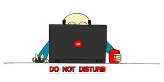 Do not disturb. Very busy man at the office, working at his laptop Stock Photo