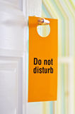 Do not disturb. A hotel doorknob label with the words 'Do not disturb' on it Royalty Free Stock Photography