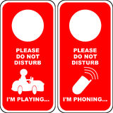 """Do not Disturb [2]. Illustration of a """"Do not disturb"""" card in two variations, playing and phoning. You can cut out and use them  for your bedroom knob Royalty Free Stock Image"""