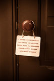 Do Not Disturb. In five languages hung on the door of a hotel Royalty Free Stock Photos