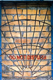 Do not disturb label on the brick-encased window Royalty Free Stock Photography