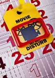 Do not disturb when movie runs 2. Do not disturb when movie runs or you are planned trip to the cinema at the weekend concept shot. Do not disturb yellow label/ royalty free stock image