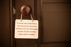 Do Not Disturb poster. Do Not Disturb in five languages hung on the door of a hotel Royalty Free Stock Image