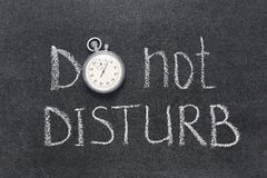 Do not disturb. Request handwritten on chalkboard with vintage precise stopwatch used instead of O Stock Photo