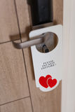 Do not disturb sign at the door of honeymoon suite Stock Photo