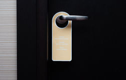 Do not disturb sign handle on a hotel door, close up Stock Images