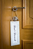 Do not disturb sign hang on door knob Royalty Free Stock Photography