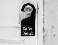 Do not disturb sign hang on door knob Stock Photography