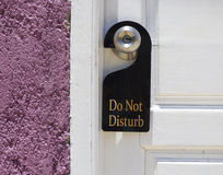 Do not disturb sign hang on door knob Stock Images