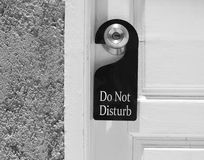 Do not disturb sign hang on door knob Stock Photo