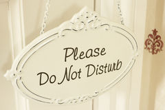 Do Not Disturb Sign Hanging On Door stock image