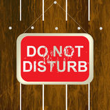 DO NOT DISTURB sign hanging on a wooden fence Stock Photography