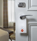 Do Not Disturb sign on hotel room`s door Royalty Free Stock Image