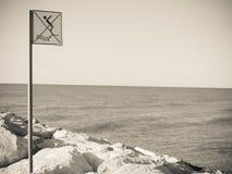 Do not dive advice long an Italian beach stock images