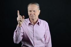 Do not do it. Senior with index finger up Royalty Free Stock Images